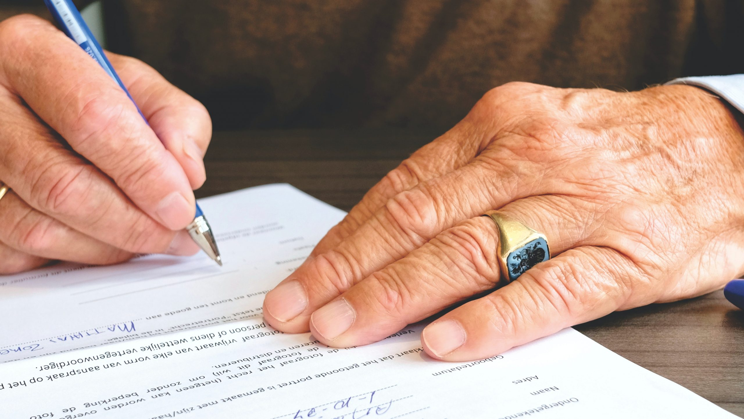 Medico Legal Assessment - person signing a document