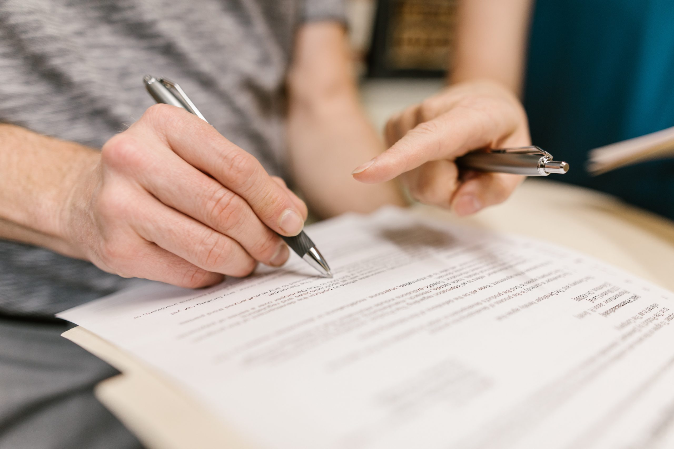 Medico Legal Specialists - people signing documentation