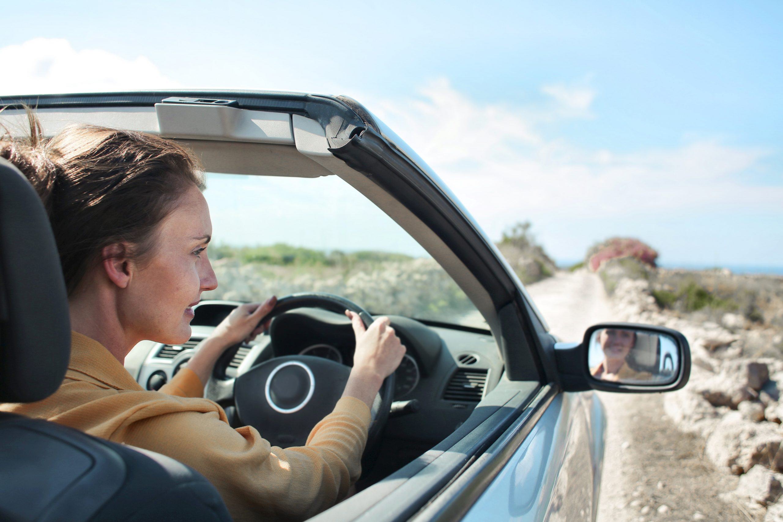 Driving Assessment and Rehabilitaton - woman driving car with the top down