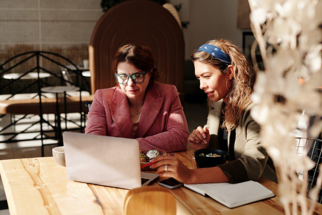 NDIS - two women sitting at table using laptop