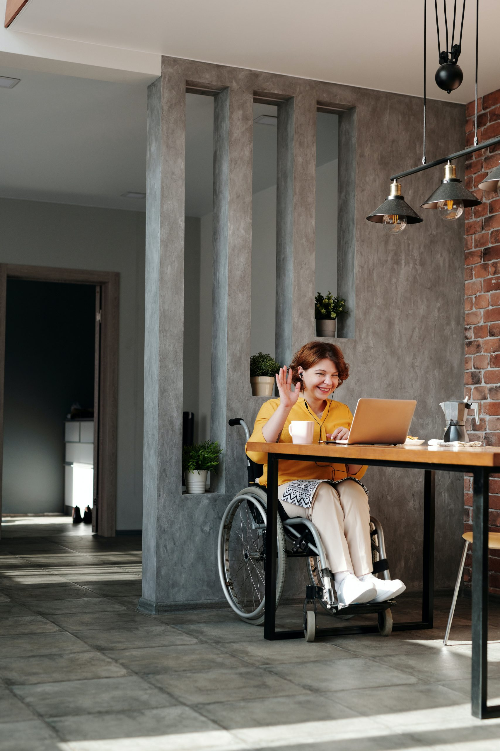 NDIS - woman in wheelchair sitting at table